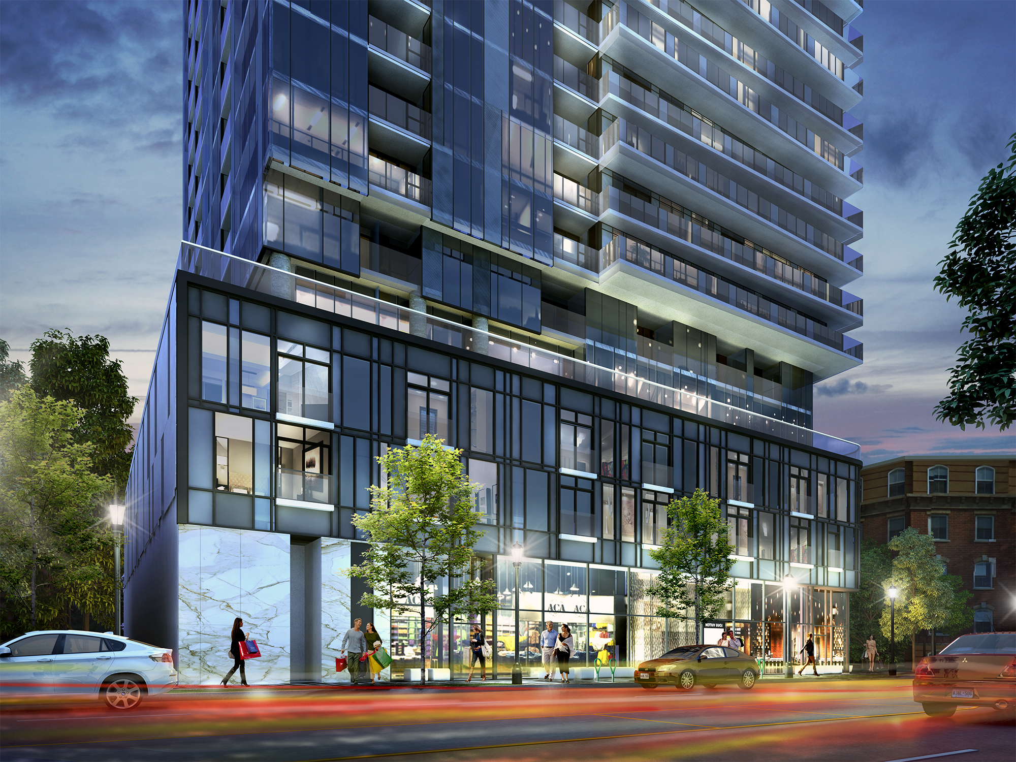 Artful interplays of grey and white glass compose Nautique's stunning five-storey podium above the lobby entrance