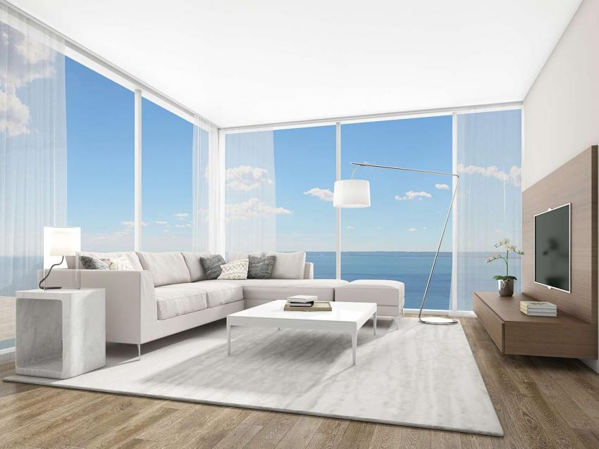 Floor-to-ceiling windows regale living spaces with light and seemingly endless views